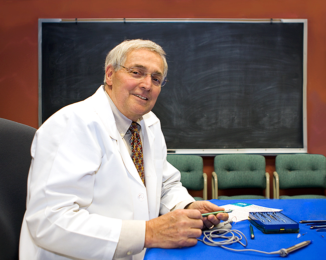 Henry Edelhauser, PhD with surgical instruments